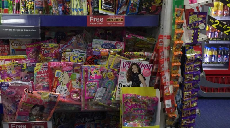 Comics on sale in WH Smiths Lancaster in July 2017. Teen titles such as 2000AD and Commando are racked in a separate section of the store.