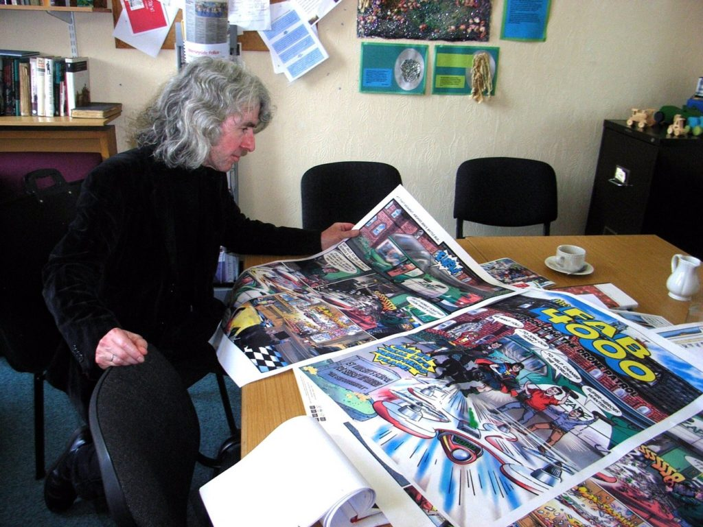 TIm Quinn looks over some The Fab 4000 art