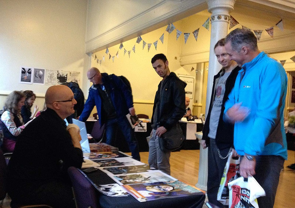 Artist Gary Erskine chatting with fans in the Clock Tower at last year's Lakes International Comic Art Festival. Far left: locally-based artist Kate Holden. In the background: artist Conor Boyle on the Disconnected Press stand