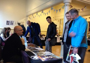 Artist Gary Erskine chatting with fans in the Clock Tower at the Lakes International Comic Art Festival. Far left: locally-based artist Kate Holden. In the background: artist Conor Boyle on the Disconnected Press stand