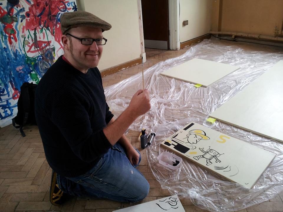 Neill Cameron at work on his giant comics mural for the Story Museum, Oxford. Image courtesy the Story Museum