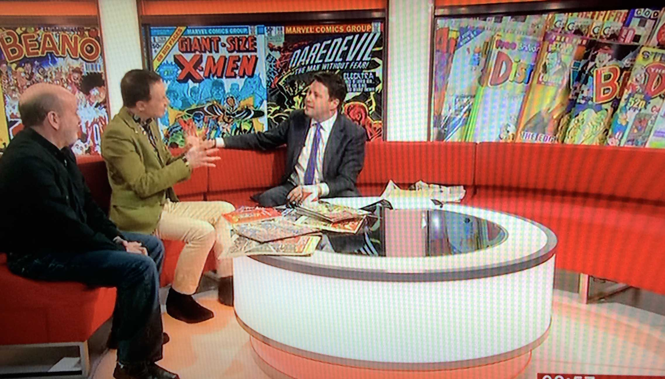 Paul Gravett on BBC News with David Huxley, talking about the British Library's Comics Unmasked exhibition
