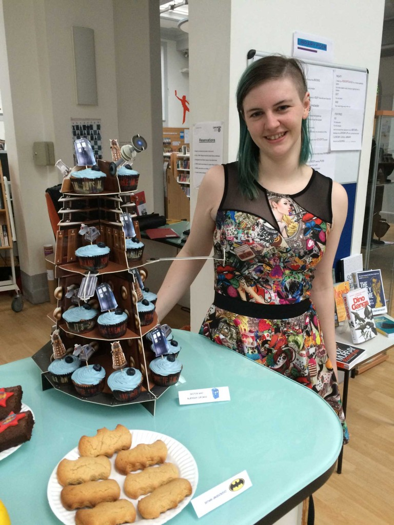 Baker Katie White and some of her comic cake on sale on the day. Photo: John Freeman