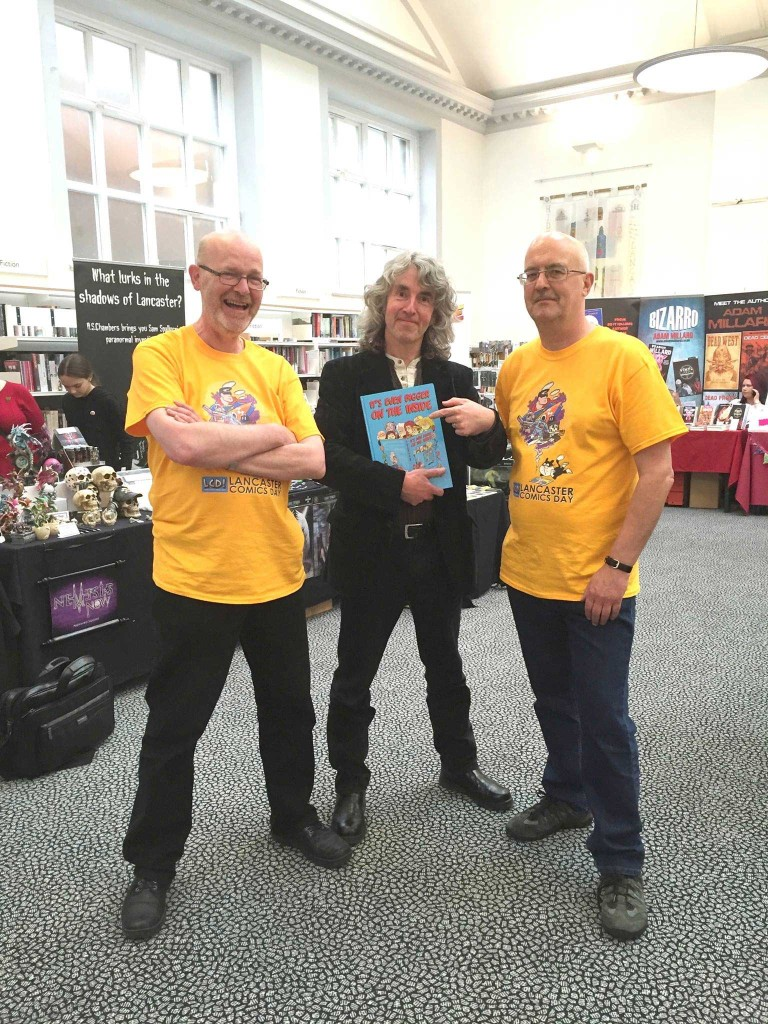 Comics Day team members John Freeman and stalwart of the event Stuart Reynolds, who co-oridnated the work of the Friends and library staff, with guest Tim Quinn. Photo courtesy Friends of Lancaster Library.