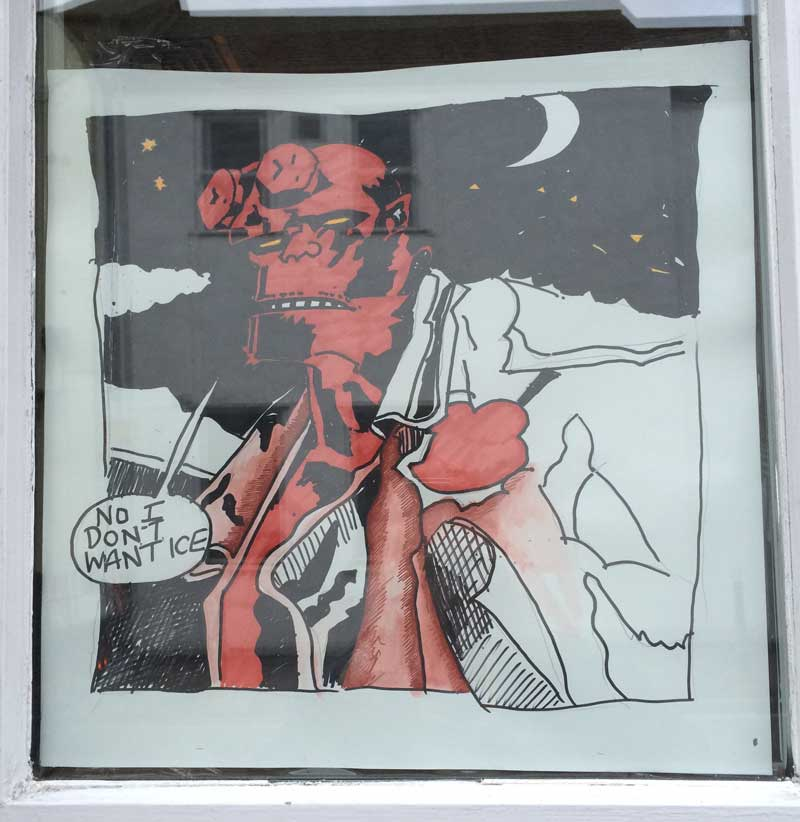 Hellboy art in the window of Wetherspoons, Kendal, in 2014.