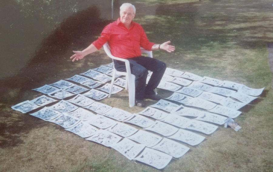 "Gordon Livingstone in his garden, with the art that featured in Commando Issue 2786 ""Protect or Die"", published in August 1994."