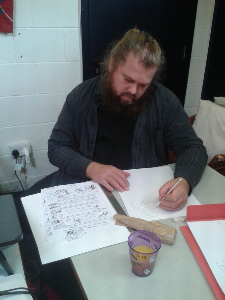 """Finnish cartoonist Petteri Tikkanen at work on his pages for """"Coelifer Atlas"""", this year's marathon comic project in aid of OCD Action"""
