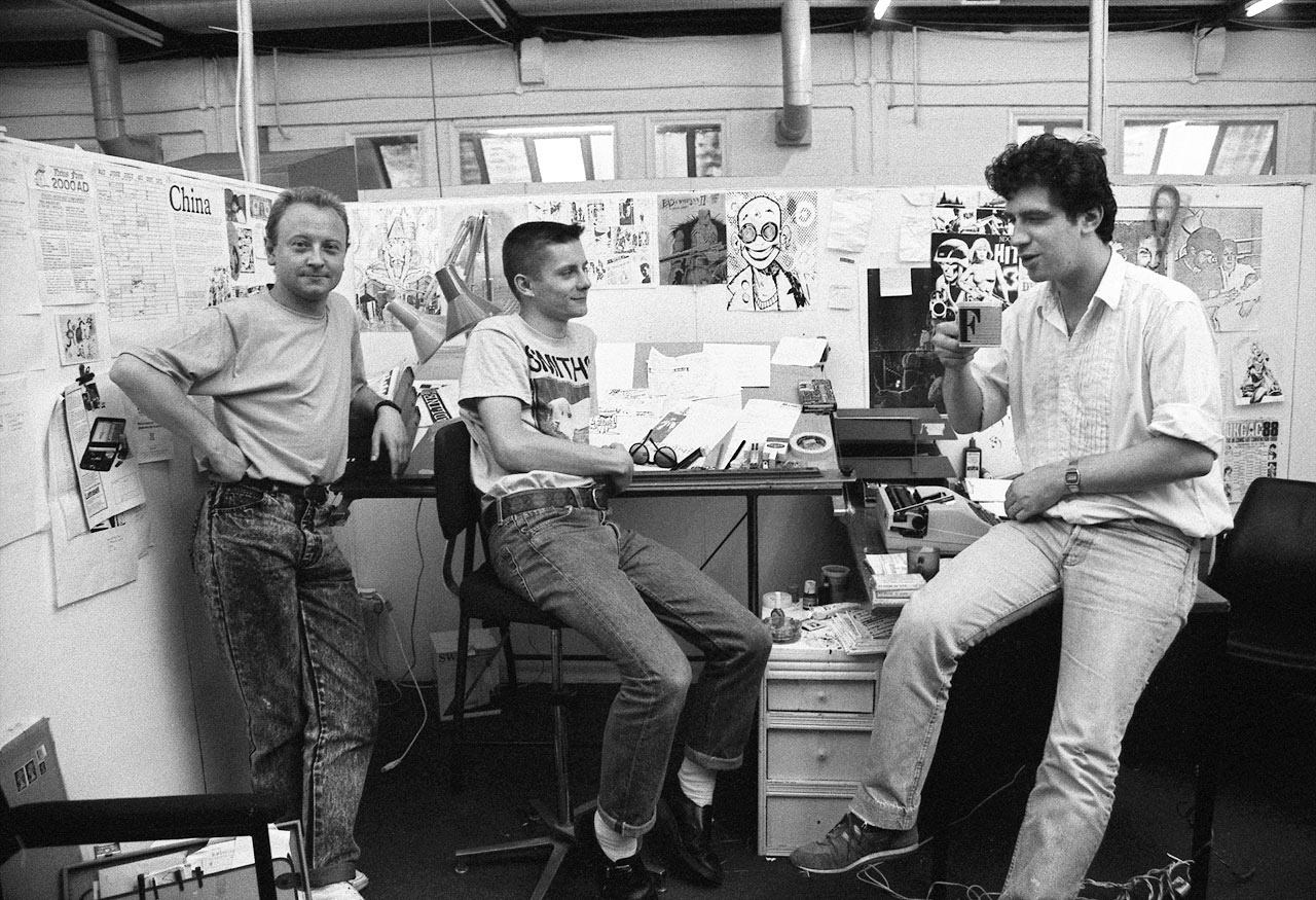 Brett Ewins, Jamie Hewlett and Steve Dillon in the Deadline office in 1988. Photo courtesy Steve Cook / National Portrait Gallery