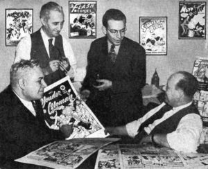William Moulton Marston, artist H. G. Peter, writer, artist and editor Sheldon Mayer and National Periodicals and All-American Publications comics publisher Max Gaines in 1942.