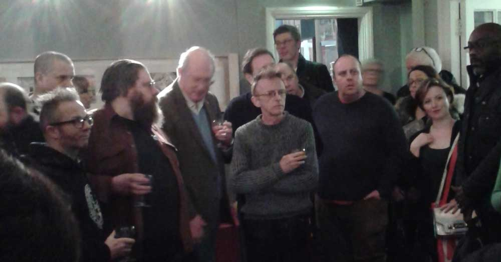 Exhibition organiser Steve Marchant (centre, in grey) at the launch of Future Shock! 40 Years of 2000AD