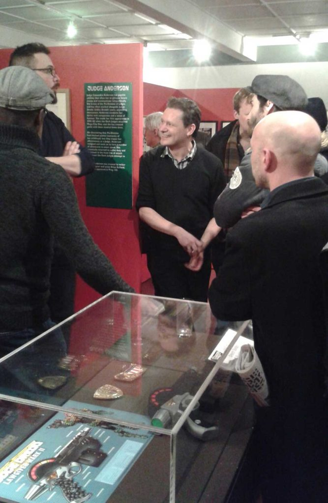 2000AD's head of PR Michael Molcher (far left, with beard), holds court