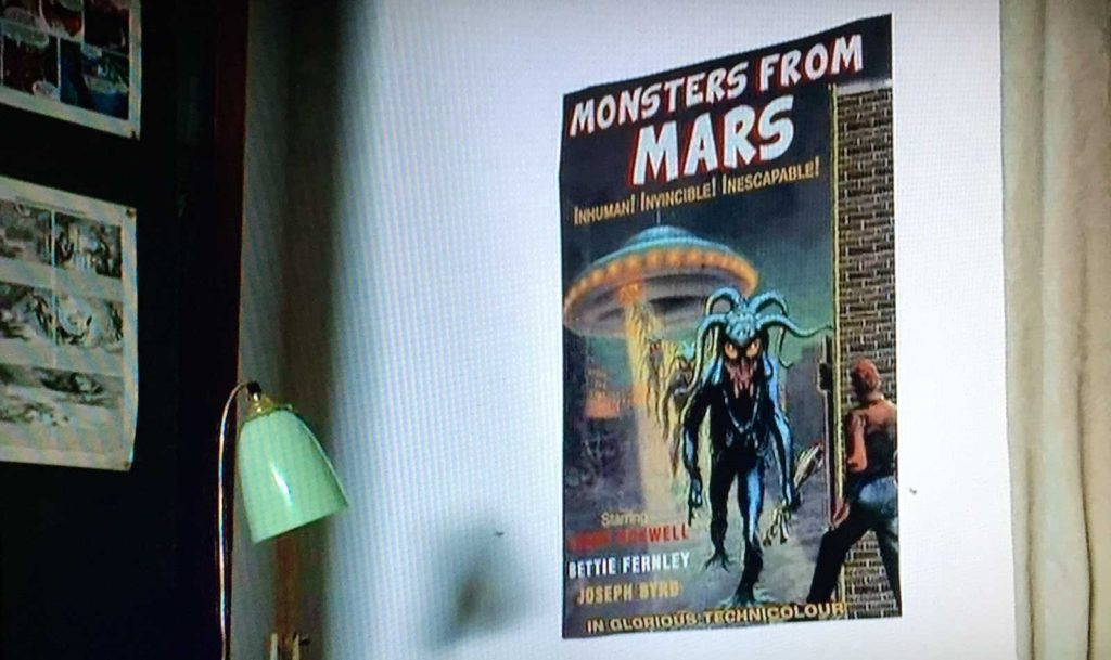 Based on Frank Kelly Freas' cover for Unknown Worlds of Science Fiction #1, not only was a Monsters from Mars poster on display, Kembleford's villagers even got to see the film in the local hall