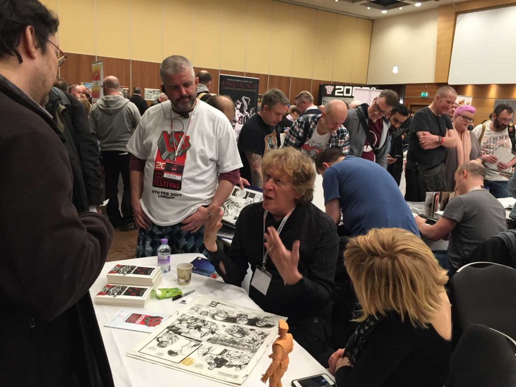 Pat Mills was also very busy at his table, while Lisa Mills sat ready to strike down the unruly who reminded Pat about once writing a story about a blind tennis player with a single blow...