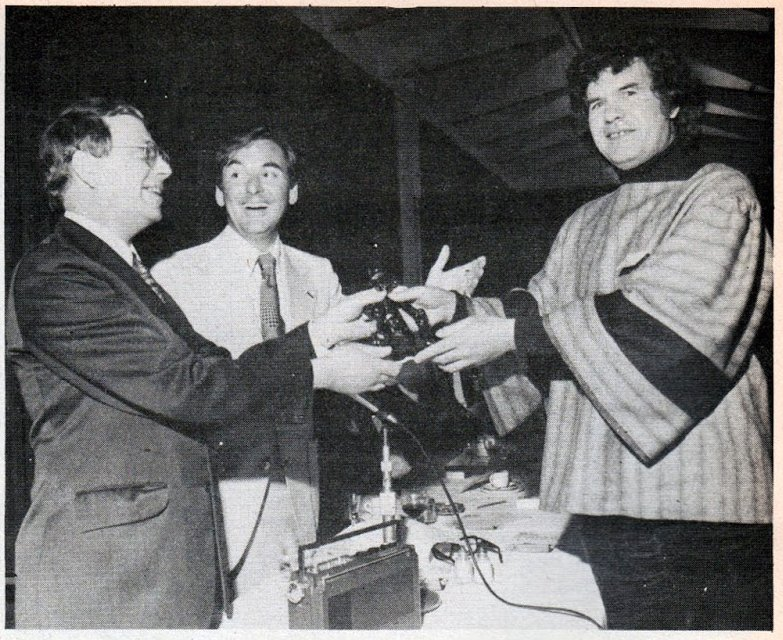 """1976. Leo Baxendale receives the Ally Sloper Award at """"Comics 101"""" from Bob Monkhouse and Denis Gifford."""