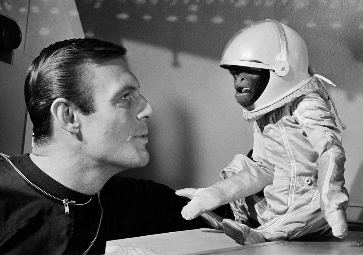 "Adam West with with ""Barney the Woolly Monkey"" in the 1964 film Robinson Crusoe on Mars"