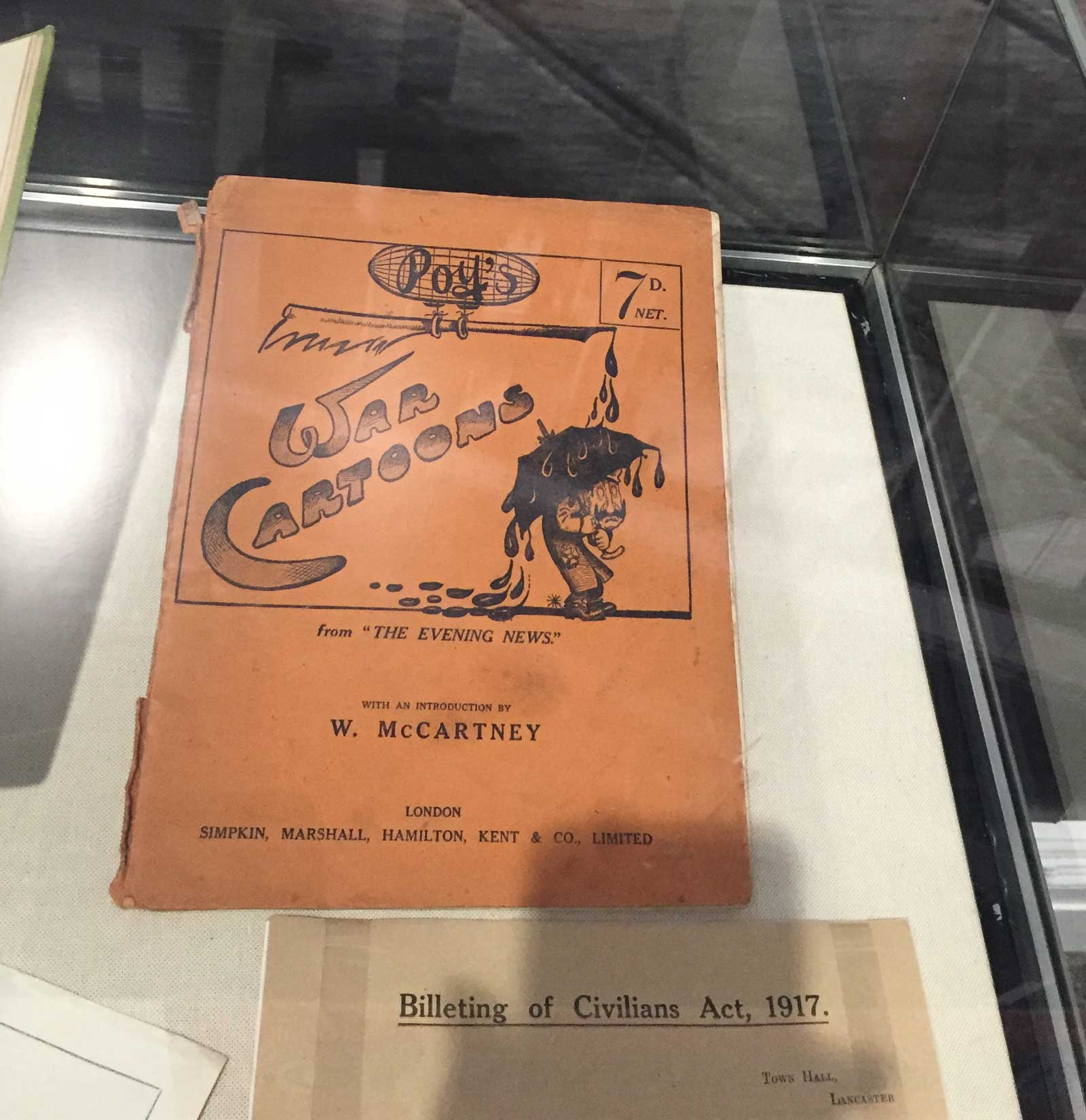 """Along with paintings from the Museum's huge collection of King's Own -related art, there's also memorabilia such as this intriguing-looking :War Cartoons"""" book on display"""