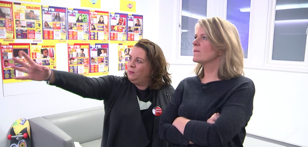 """Emma Scott, Head of Beano Studios London, explains items on the office """"mood board"""" capturing viewers and readers opinions, to Channel Four News Business Editor Siobhan Kennedy"""