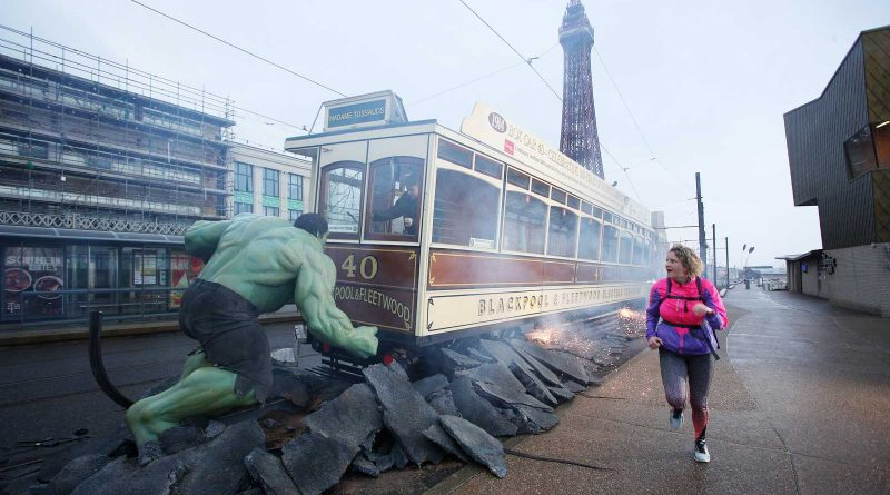 An early morning jogger gets a bit of a surprise as the Hulk takes on a Blackpool tram. Image: Madame Tussauds